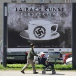 A man walks past a billboard for the art exhibition of the group Laibach Kunst on a street in Ljubljana April 6, 2011.  REUTERS/Srdjan Zivulovic (SLOVENIA - Tags: SOCIETY)